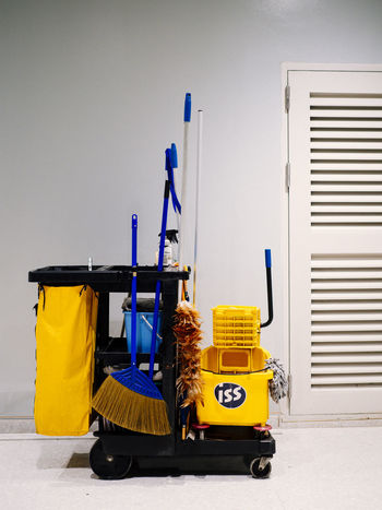 Absence Architecture Bag Blue Building Building Exterior Built Structure Cart Day Land Vehicle Large Group Of Objects Mode Of Transportation No People Outdoors Still Life Street Transportation Wall - Building Feature Yellow