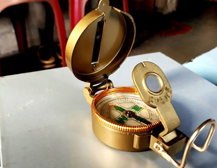 The Golden Compass Golden Compass Gold Magic Compass Golden Compass Metal Indoors  No People Technology Close-up