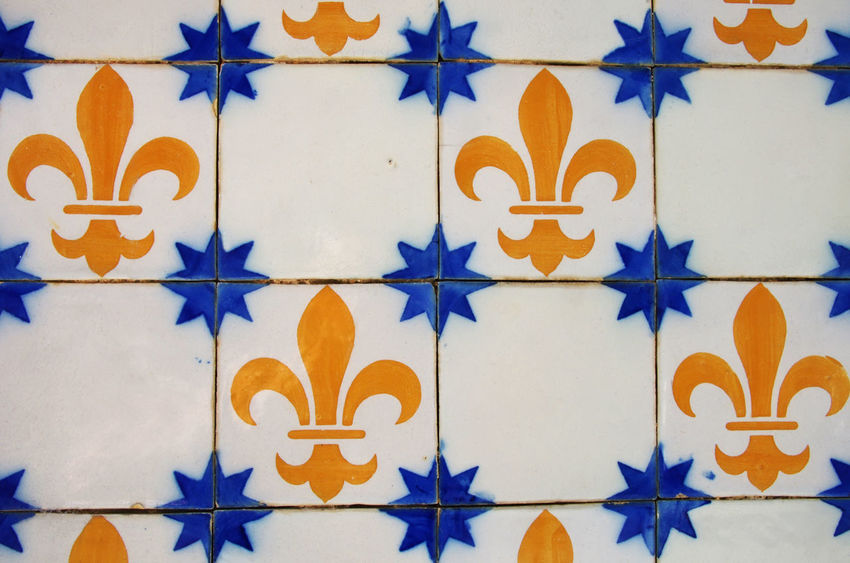 Yellow, Blue and White Tiles, at portuguese street Tiles, At Portuguese Street Backgrounds Blue Close-up Design Floral Pattern Full Frame Geometric Shape Pattern Portuguese Street Tile Wall - Building Feature