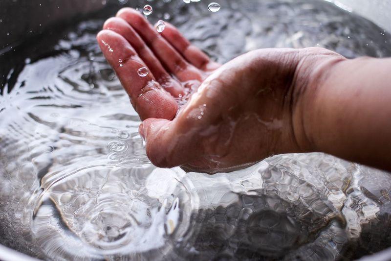 Cropped image of man splashing water