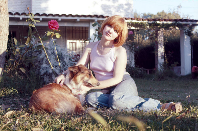 At The Garden Beautiful Day Collie Dog Daylight Dog Flowers Front View Garden Grass Lifestyles Looking At Camera Nature Outdoors Red Hair Redhair Relaxing Sitting Smiling Vacation Weekend Activities Young Women