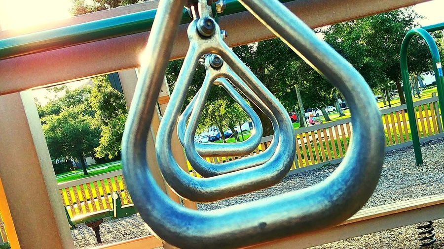 askew playground Middle Through Nostalgia Swing Manatee Park New Smyrna Beach NSB Life Dad Nsb Metallic Metal Chain Tree Sunlight Outdoor Play Equipment Monkey Bars Rusty Playground Geometric Shape Nut - Fastener Iron Jungle Gym EyeEmNewHere