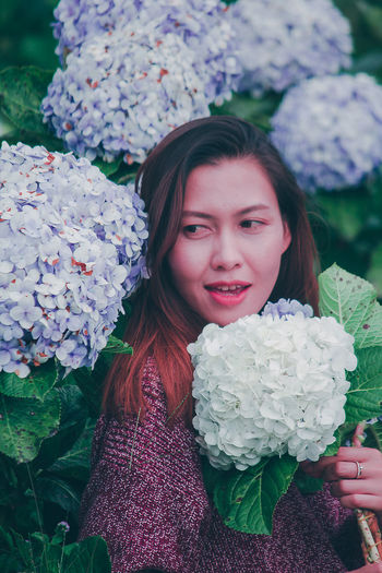 Portrait of beautiful woman with pink flowers