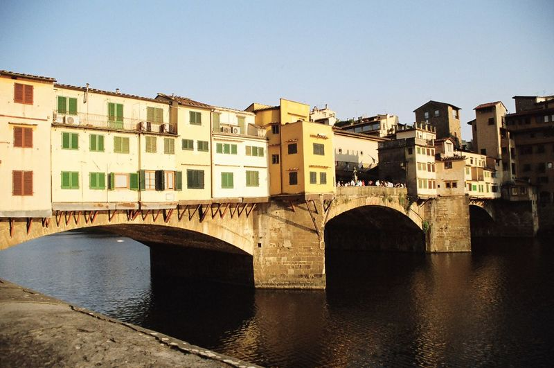 Arch Arch Bridge Architecture Blue Bridge Bridge - Man Made Structure Building Building Exterior Built Structure City Day Florence Italy Italy Outdoors Ponte Vecchio Ponte Vecchio Firenze River Sky Sunlight ☀ Travel Destinations Tuscany Water Yellow Color