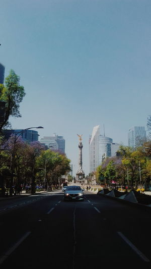 Mexico City Mexico Independence Monument Independence Angel Angel De La Independencia Street Streetphotography Movement Tree Cdmx City Cityscape Tree Modern Skyscraper Urban Skyline Sky Architecture Street Scene High Street Tall - High Downtown District Vehicle