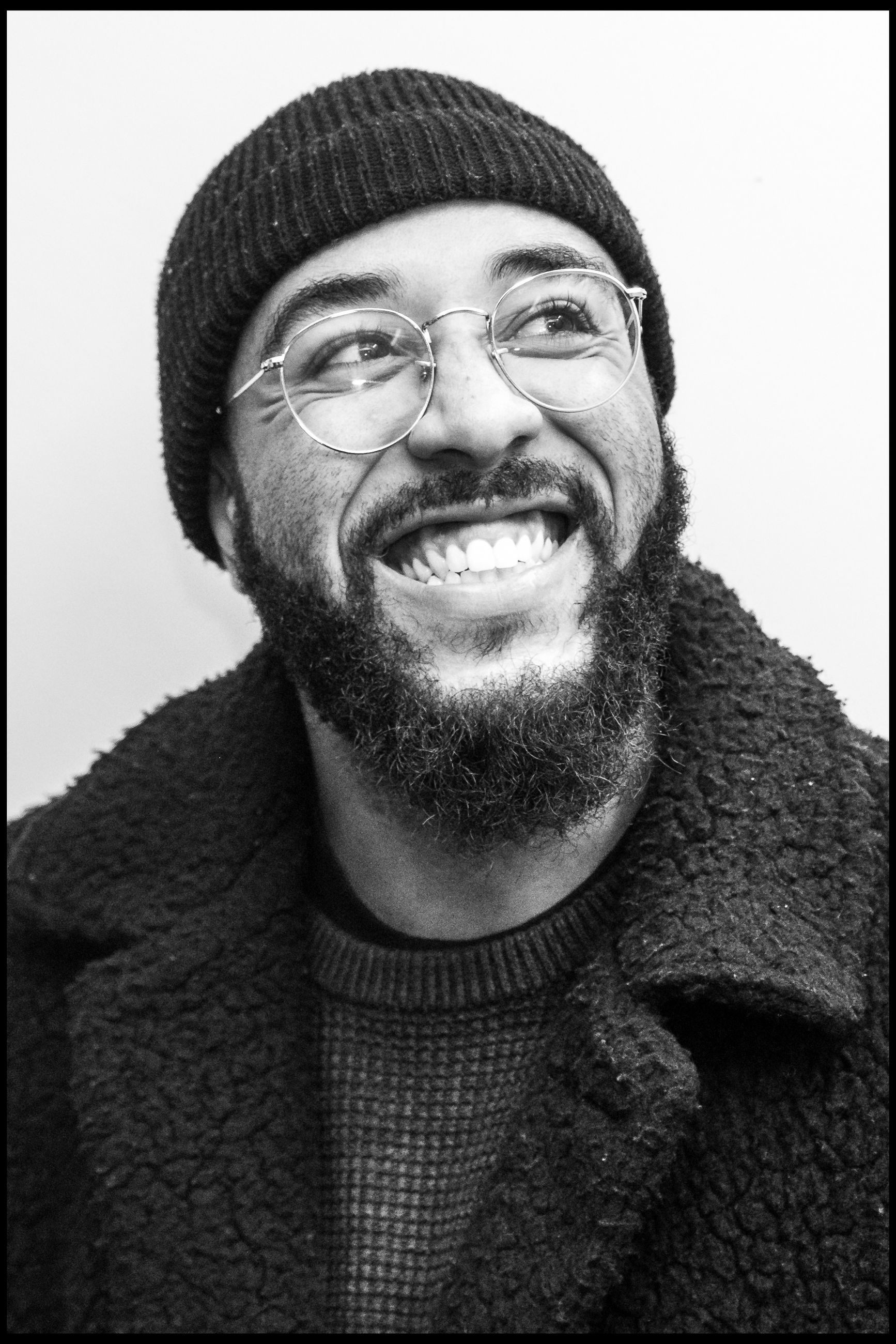 portrait, smiling, clothing, happiness, one person, front view, looking at camera, toothy smile, emotion, facial hair, headshot, teeth, beard, glasses, warm clothing, winter, sweater, real people, adult, mouth open, human face