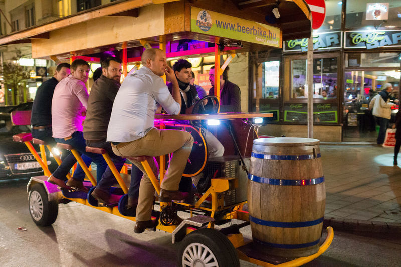 Beer Beerbike Budapest Budapest, Hungary Casual Clothing City City Life City Street Day Friend Friends Group Of People Hungary Large Group Of People Leisure Activity Lifestyles Market Market Stall Medium Group Of People Mixed Age Range Outdoors Party Party Time Retail  Travel