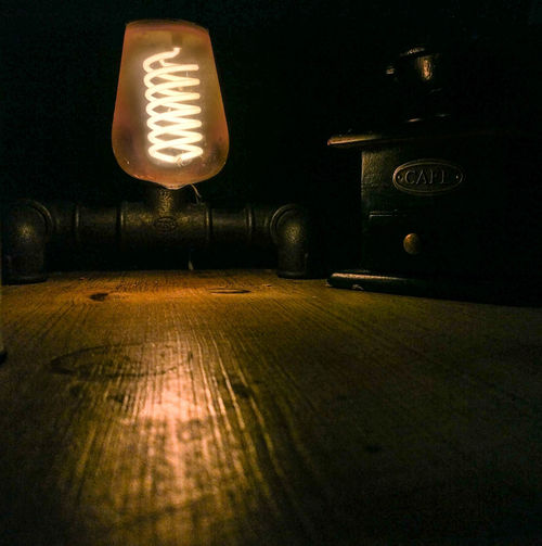 Communication Dark Domestic Room Electric Lamp Electrical Equipment Electricity  Food And Drink Glowing Illuminated Indoors  Light Light - Natural Phenomenon Lighting Equipment Nature Night No People Retro Bulb Retro Lighting Table Technology Text Western Script