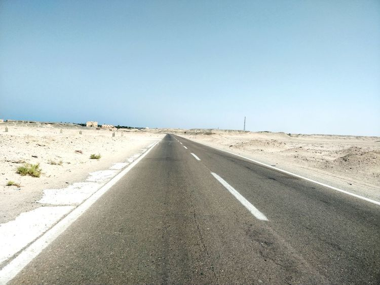 Clear Sky Arid Climate Desert Road Sand Sunny Blue Diminishing Perspective Road Marking Sky Empty Road Asphalt Dividing Line White Line Two Lane Highway Roadways The Way Forward Leading vanishing point Straight Mountain Road Tire Track Horizon Over Land