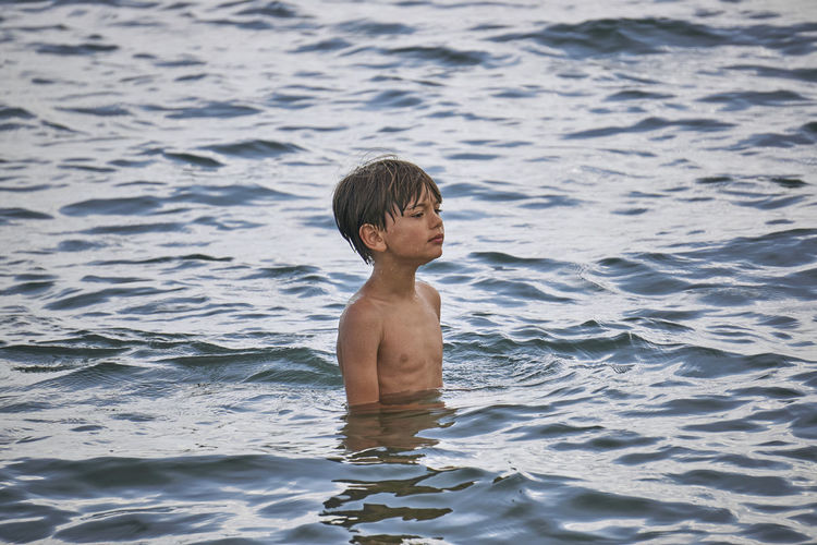 Calm Boy Child Childhood Day Innocence Leisure Activity Lifestyles Males  Men Nature One Person Outdoors Real People Sea Shirtless Swimming Three Quarter Length Water Waterfront EyeEmNewHere