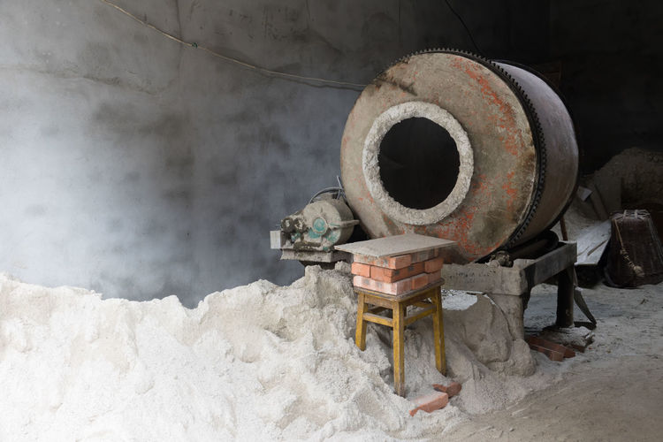 Cement mixer machine at construction site, tools and sand Industry Metal Abandoned Old Rusty Day Machinery No People Land Equipment Outdoors Decline Architecture Deterioration Damaged Field Wheel Cement Development Construction Industrial Mixer