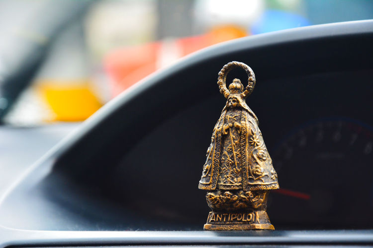 Close-Up Of Figurine In Car