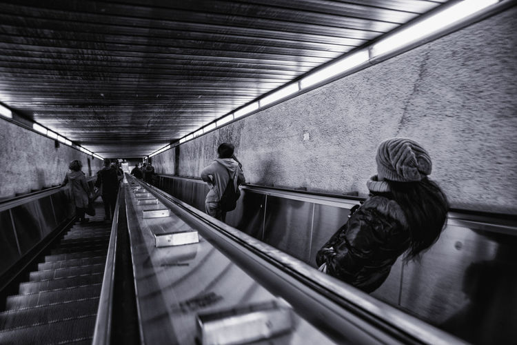 Rear view of people on escalators