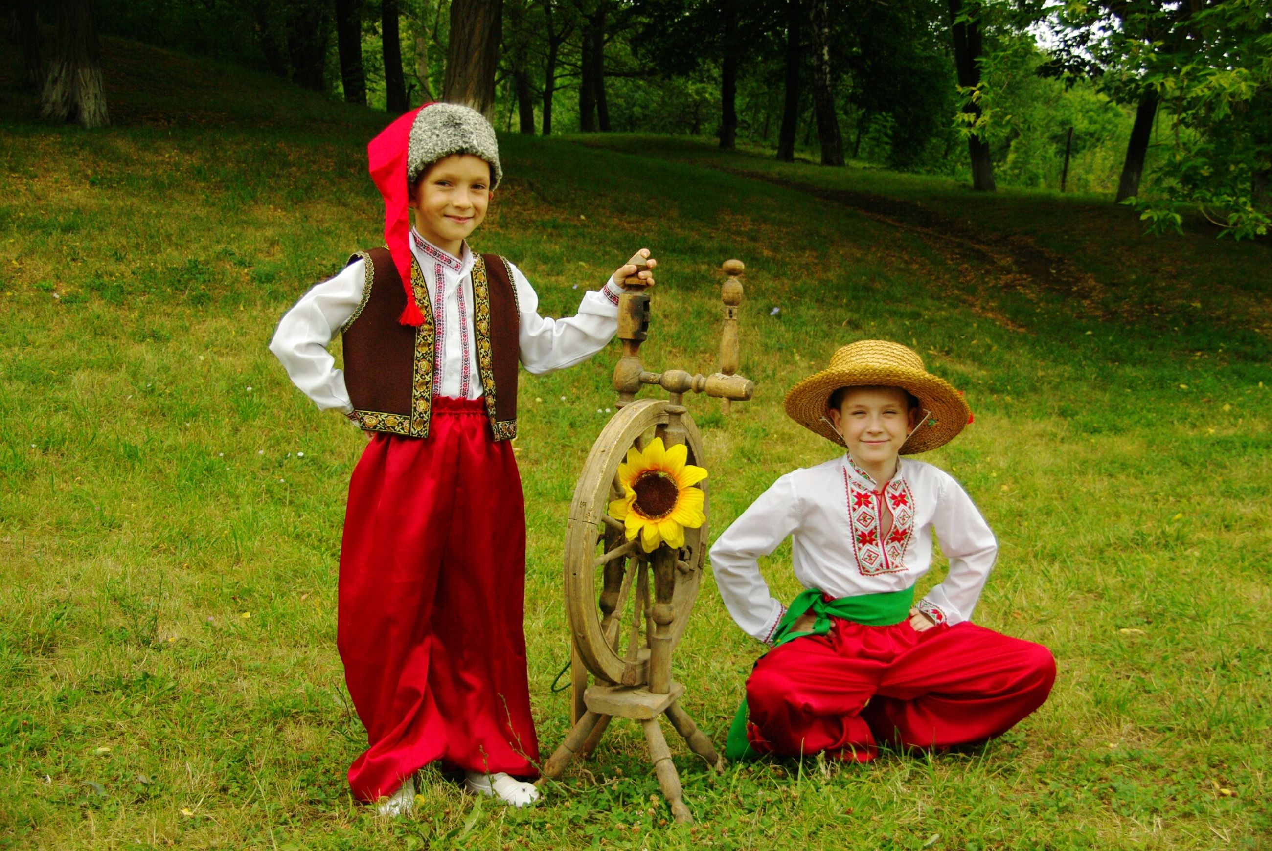 looking at camera, portrait, childhood, grass, full length, dressing up, hat, traditional clothing, togetherness, children only, halloween, girls, front view, outdoors, tradition, friendship, smiling, child, witch, day, tree, standing, people, clown, adult