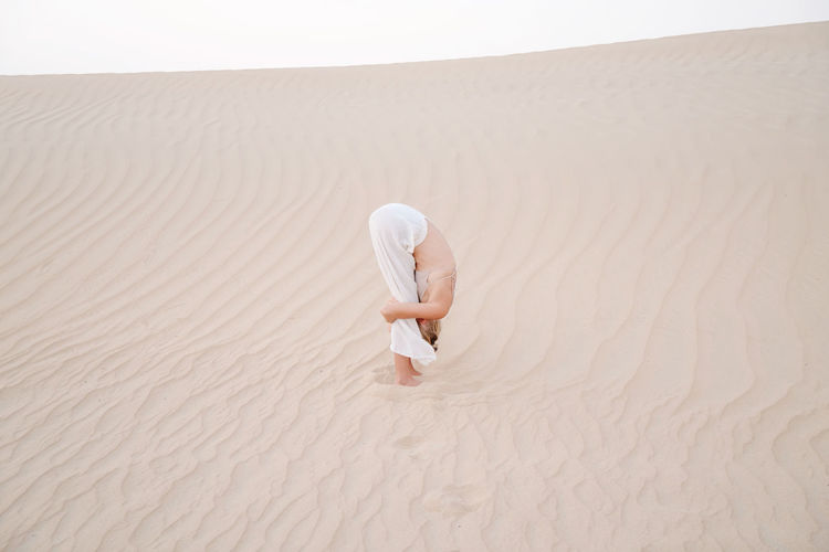 Full length of man on sand dune