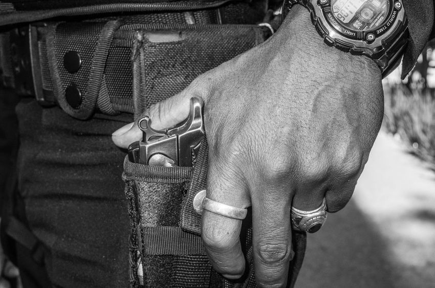 Close up of a police gun 911 Best EyeEm Shot Black & White Gun Pistols Policeman WeekOnEyeEm Wristwatch Black And White Black And White Photography Blackandwhite Blacknwhite Close-up Finger Fingers Firearm Hand Pistol Police Real People Ring Rings Unrecognizable Person Watch Week On Eyeem