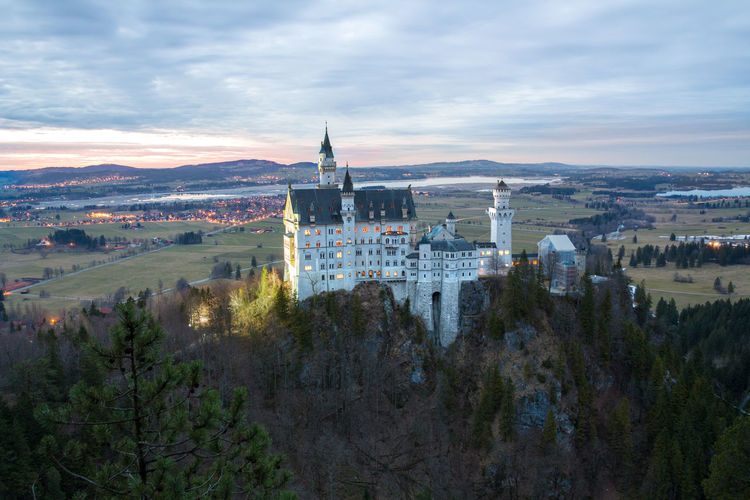 Just kidding :P This is the famous castle Neuschwanstein in Bavaria - Germany. My quick stopover definetely payed out as I got some beautiful shots in the blue hour. It was my first visit ever and the beauty of the surrounding landscape in combination with the castle just amazed me! Aerial View Architecture Bavaria Bridge - Man Made Structure Building Exterior Built Structure Castle Cloud - Sky Cultures Day Government High Angle View Modern Mountain Nature Neuschwanstein No People Outdoors Place Of Worship Sky Sunset Tourism Travel Travel Destinations Tree Been There.