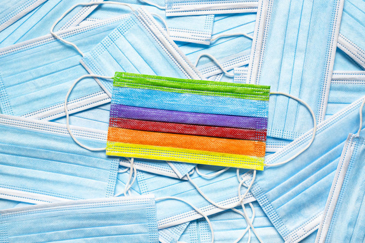 High angle view of multi colored pencils against blue background