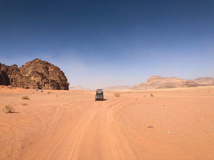 Trip into the desert Landscape_Collection Landscapes Horizon Wadi Rum Desert Desert Beauty Desert Land Transportation Mode Of Transportation Sky Environment Landscape Scenics - Nature Land Vehicle Arid Climate Nature Climate Sand Travel Motor Vehicle 4x4 Off-road Vehicle Non-urban Scene Road