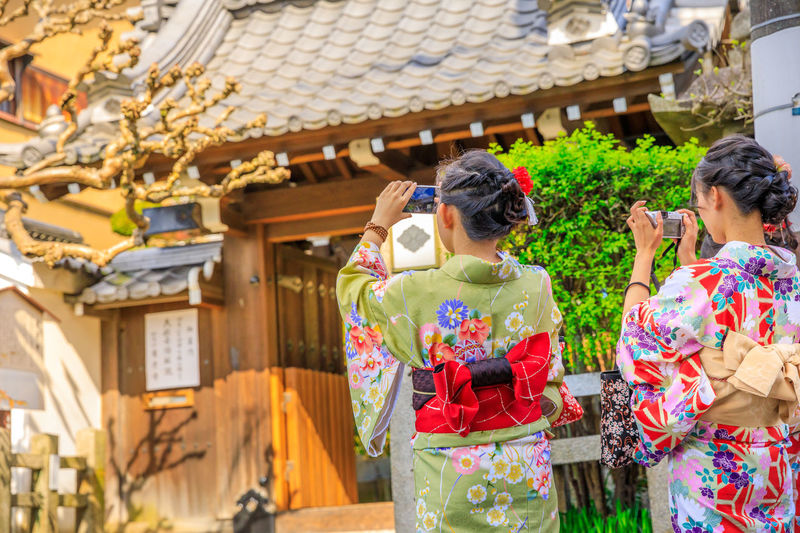 Three Japanese women in kimono take picture of paper lanterns of Yasaka Shrine in Kyoto, Japan. Gion Shrine is one of the most famous shrines in Kyoto between Gion District and Higashiyama District. Kyoto Kyoto,japan Kyoto, Japan Japan Temple Zen Buddist Temple Garden Tree Shrine Torii Gate Lake Garden Flowers Nature Meditation Japanese  Honden Yasaka Shrine Yasaka Pagoda Gion Shrine Gion Kyoto Higashiyama Pagoda Shinto Traditional Clothing Adult Women Architecture Kimono Lifestyles Young Adult Clothing Real People Leisure Activity Robe Holding Men Rear View Day Group Of People Outdoors