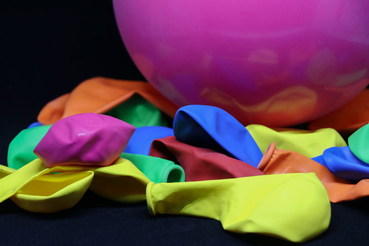 background with colorful balloons Multi Colored Still Life Indoors  No People Close-up Art And Craft Balloon Variation Blue Choice Creativity Toy Group Of Objects Selective Focus Focus On Foreground Large Group Of Objects Studio Shot Pink Color Paper Purple Black Background