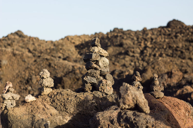 Art And Craft Clear Sky Close-up Creativity Day Focus On Foreground Human Representation Land Nature No People Outdoors Representation Rock Rock - Object Sculpture Sky Solid Stack Sunlight Tranquility EyeEmNewHere