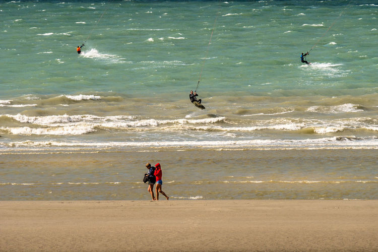 People at beach in sunny day