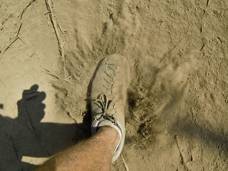 Adult Beach Close-up Day Dust Dust Cloud Foot High Angle View Human Body Part Human Foot Human Leg Low Section Men One Person Outdoors People Personal Perspective Real People Sand Shadow Shoe Shoe Standing Sunlight Tanzania