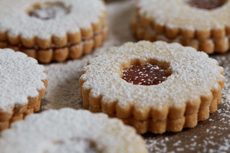 Close up of freshly baked homemade Christmas sugar cookies with jam Food And Drink Food Sweet Food Sweet Dessert Baked Freshness Indulgence Close-up Indoors  Cake No People Temptation Selective Focus Ready-to-eat Unhealthy Eating Homemade Still Life Focus On Foreground High Angle View Powdered Sugar Snack Muffin Homemade Freshness Jam Freshly Baked Freshly Cookies Cookie