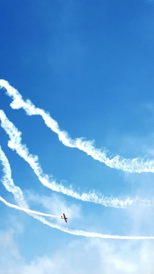 Low Angle View Of Airplane Flying Against Sky During Airshow