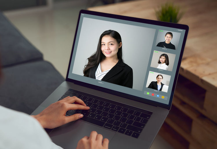 Portrait of woman using laptop on table