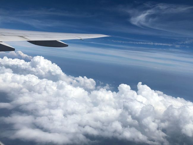 Cloud - Sky Sky Air Vehicle Flying Airplane Nature Scenics - Nature Beauty In Nature No People Transportation Aerial View Mode Of Transportation Cloudscape Day Outdoors Aircraft Wing Tranquility Environment Mid-air Tranquil Scene