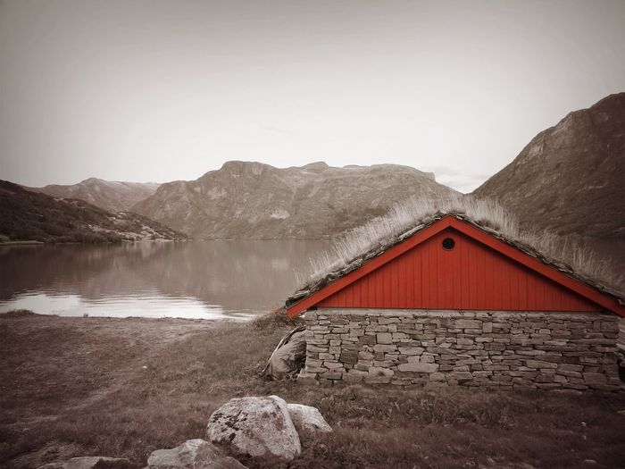 Norway Architecture Beauty In Nature Black And Red Colour Building Exterior Built Structure Cold Temperature Day Idyllic Lake Mountain Mountain Range Nature No People Non-urban Scene Scenics - Nature Sky Tranquil Scene Tranquility Water