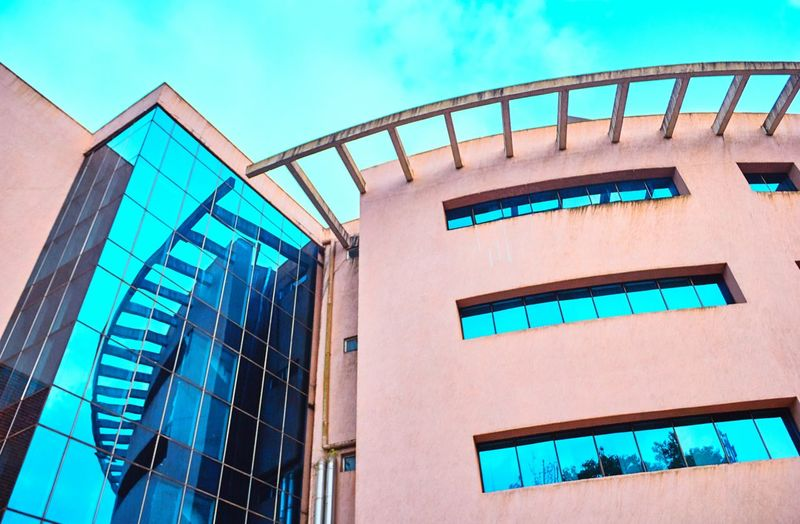 No People Sky Blue Day Cloud - Sky Manipal Intitute Of Technology Building Exterior Architecture Wall - Building Feature Textured  Pattern Detail Modern Manipal Exterior College Window Building Built Structure Brick Wall Low Angle View Directly Below The Architect - 2016 EyeEm Awards Architectural Feature Manipalscenes The Architect - 2017 EyeEm Awards