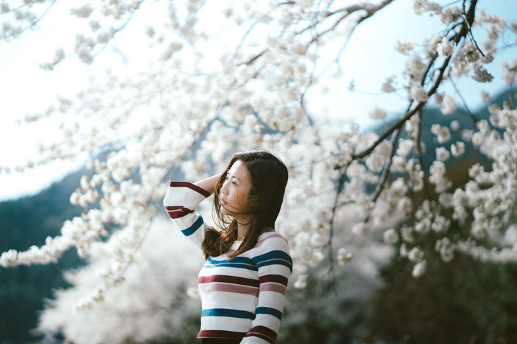 Japan Travel Advanture Lifestyles Outdoors Sakura Blossom Springtime Standing Wind Young Women