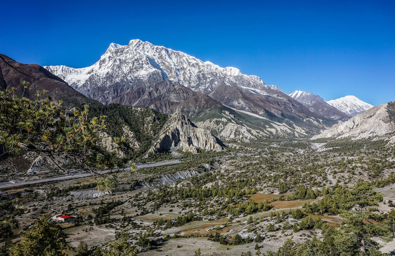 Shot of Manang Valley taken during descending from Kang La Pass. Nepal Nepal Travel Annapurna Conservation Area Annapurnacircuit Manang Valley Mountain Scenics - Nature Mountain Range Sky Beauty In Nature Landscape Environment Tranquil Scene Clear Sky Nature Non-urban Scene No People Idyllic Outdoors Snowcapped Mountain Mountain Peak Geology Rock Valley Hiking