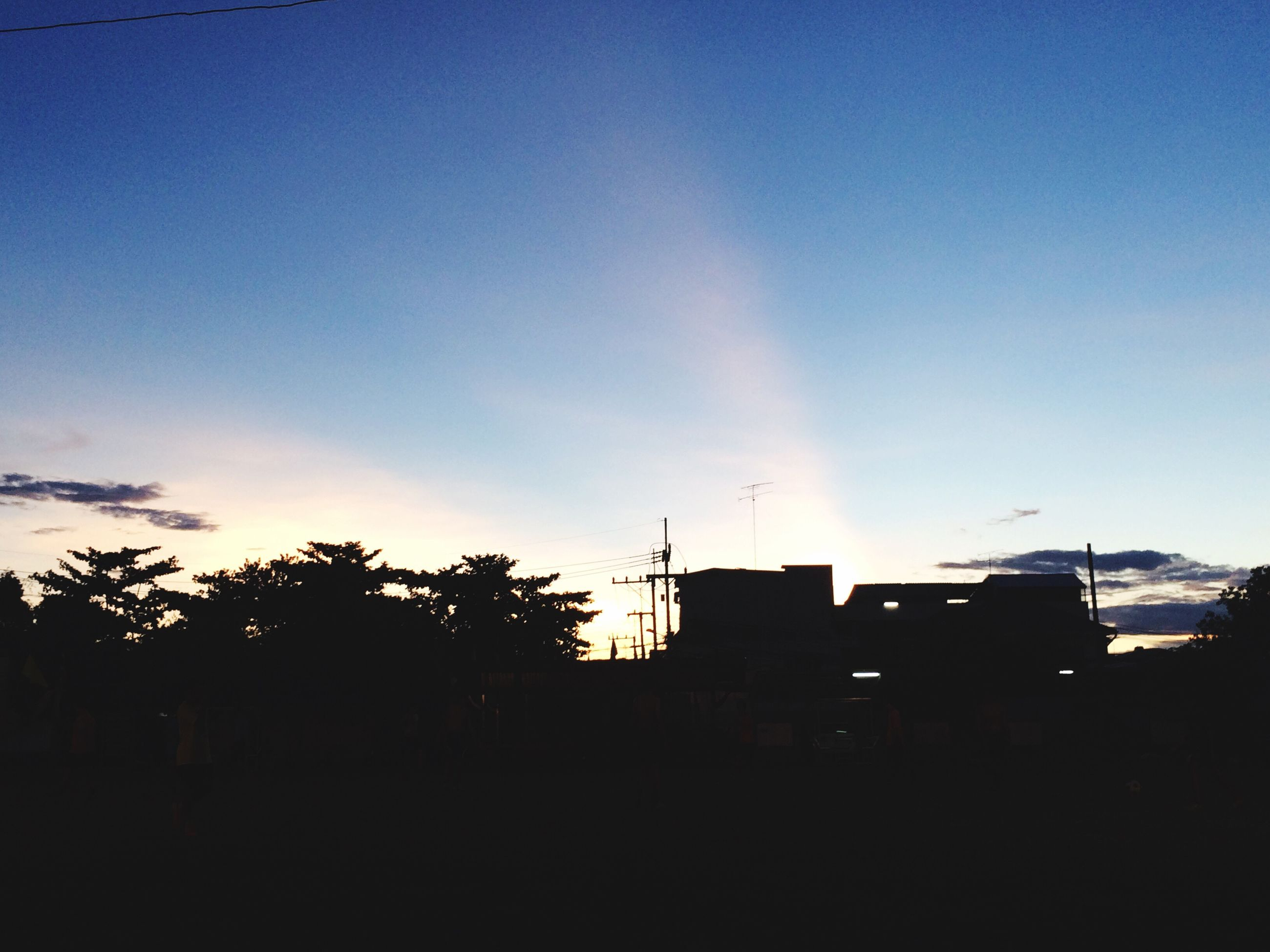 building exterior, architecture, built structure, silhouette, blue, sky, copy space, low angle view, house, sunset, tree, residential structure, sunlight, clear sky, building, residential building, outdoors, no people, dusk, nature