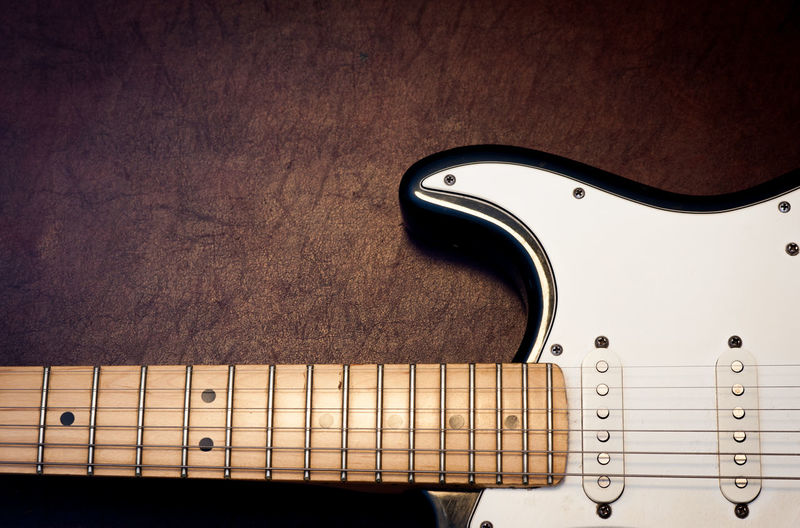 Cropped Image Of Electric Guitar On Table
