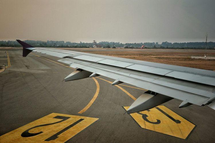 Aircraft wing of airplane at runway