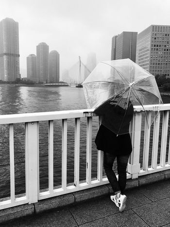 Tokyo bridge Architecture Skyscraper City Building Exterior Built Structure Water Real People Full Length One Person Railing Outdoors Day Urban Skyline Rear View City Life Lifestyles Standing Cityscape Men Sea Travelphotography Japan Photography Travel Instadaily Blackandwhite