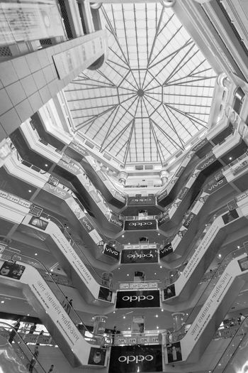 Low angle view of buildings in shopping mall