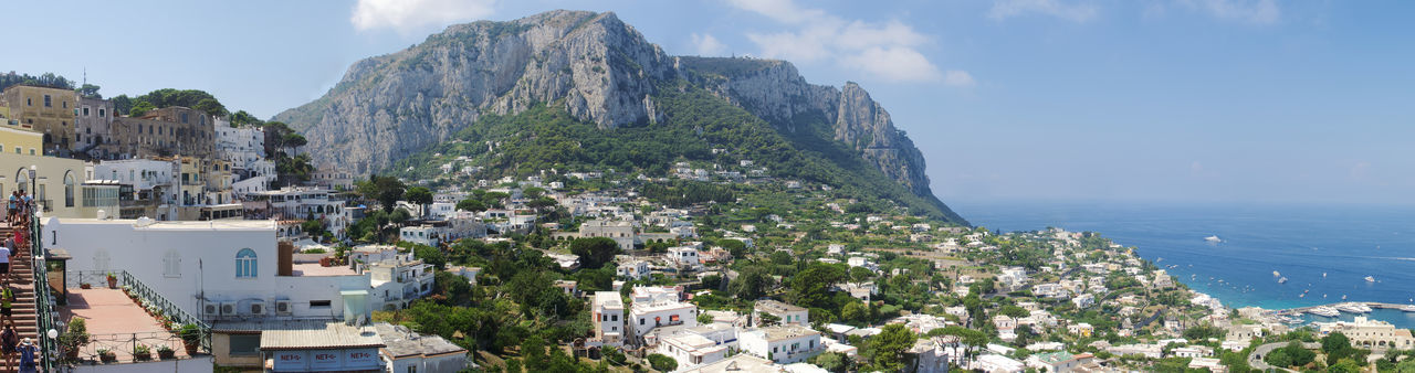 Panoramic shot of capri by sea against sky