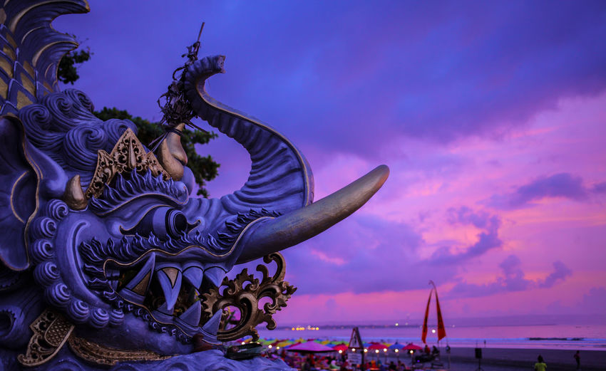 Animal Representation Architecture Art And Craft Beach Beauty In Nature Cloud - Sky Craft Creativity Dragon Dusk Nature Nautical Vessel No People Outdoors Purple Representation Sculpture Sea Sky Statue Violet Water