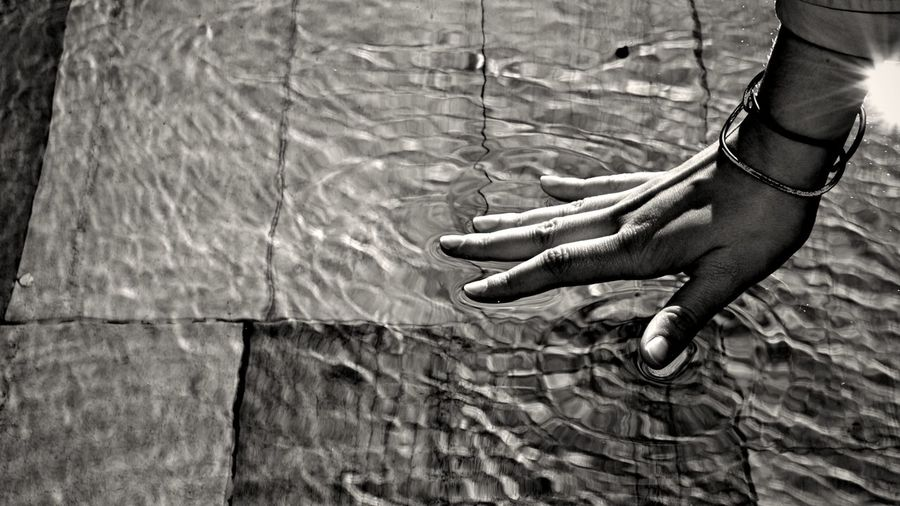 Hand of woman in water