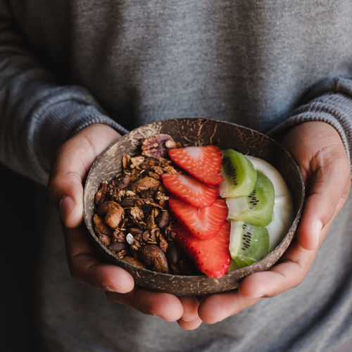 One Person Hand Food And Drink Holding Human Hand Food Healthy Eating Real People Midsection Freshness Wellbeing Lifestyles Human Body Part Fruit Leisure Activity Close-up Focus On Foreground Indoors  SLICE Finger Yogurt Coconut Bowl Bowl