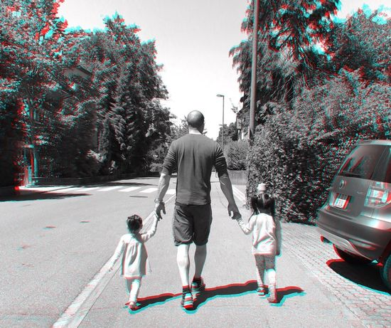 Walking Rear View Father Full Length Tree Car Family With One Child Togetherness Transportation Daughter Real People Child Childhood Day Outdoors Men Lifestyles Adult Road People
