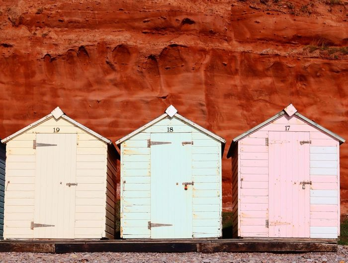 Beach Hut Beach Photography Built Structure Building Exterior Day No People Side By Side Wall - Building Feature Entrance Weathered Sunlight Hut