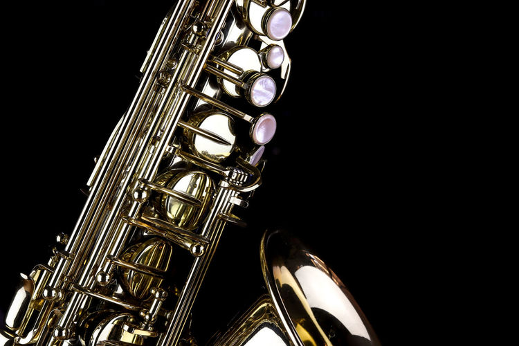 Music Instrument Alto Saxophone, Saxophone Isolated on black Studio Shot Musical Instrument Music Black Background Indoors  Arts Culture And Entertainment Metal Copy Space Musical Equipment Wind Instrument Close-up Brass Instrument  No People Brass Gold Colored Shiny Cut Out Saxophone Jazz Music Trumpet