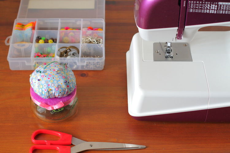 High angle view of sewing items on table