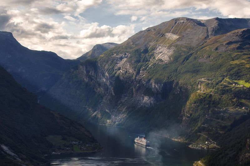 High Angle View Of Ship Moving From Fjord On Sea